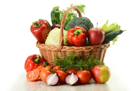 Composition with raw vegetables and wicker basket isolated on white Stock Photo - 9110218