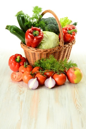 Composition with raw vegetables and wicker basket isolated on white Stock Photo - 9110231