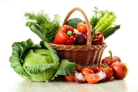 Composition with raw vegetables and wicker basket isolated on white Stock Photo - 9110223