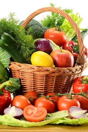 Composition with raw vegetables and wicker basket Stock Photo - 9110243