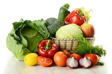 Composition with raw vegetables and wicker basket isolated on white Stock Photo - 9110227