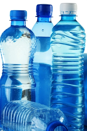 Polycarbonate plastic bottles of mineral water on white background  photo