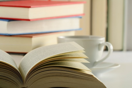 Composition with books and cup of coffee on the table Reklamní fotografie
