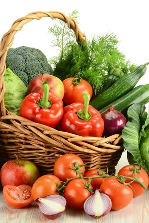 Composition with raw vegetables and wicker basket Stock Photo - 9424125