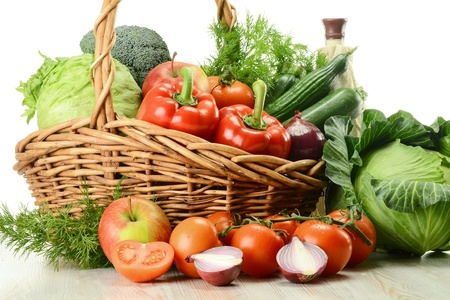 Composition with raw vegetables and wicker basket Stock Photo - 9424124