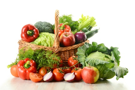 Composition with raw vegetables and wicker basket isolated on white Stock Photo - 9367172