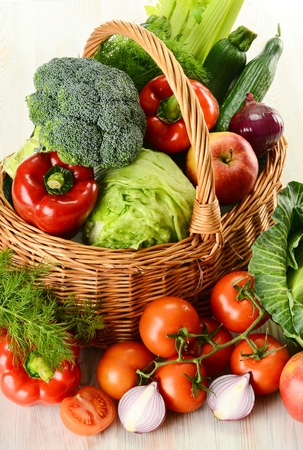 Composition with raw vegetables and wicker basket isolated on white Stock Photo - 9367182