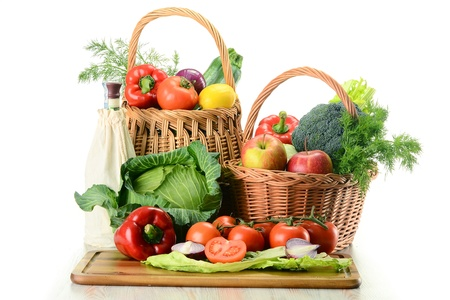 Composition with raw vegetables and wicker basket isolated on white Stock Photo - 9367171