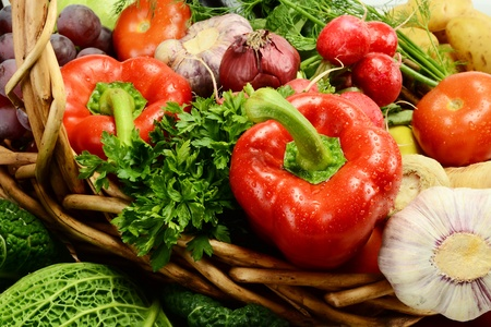 breakfast garden: Composition with raw vegetables and wicker basket