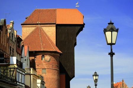 szeroka: The medieval port crane Zuraw over Motlawa river in center of Gdansk, Poland