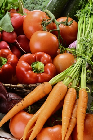 Composition with raw vegetables and wicker basket Stock Photo - 9642778