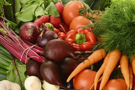 Composition with raw vegetables and wicker basket Stock Photo - 9642850