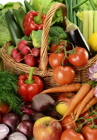 Composition with raw vegetables and wicker basket Stock Photo - 9642802