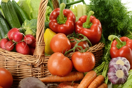 Composition with raw vegetables and wicker basket Stock Photo - 9642763