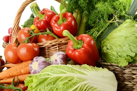 Composition with raw vegetables and wicker basket Stock Photo - 9642803