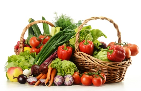 Composition with raw vegetables and wicker basket isolated on white Stock Photo - 9642775