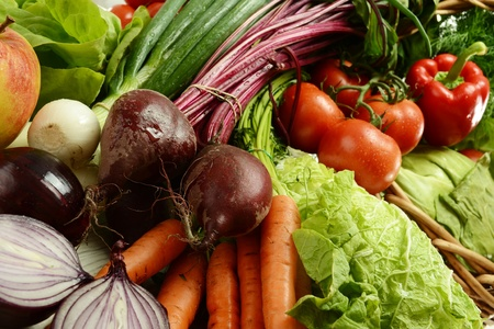 Composition with raw vegetables and wicker basket Stock Photo - 9642804