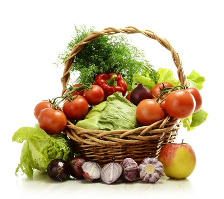 Composition with raw vegetables and wicker basket isolated on white Stock Photo - 9642750