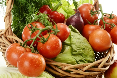Composition with raw vegetables and wicker basket Stock Photo - 9642814