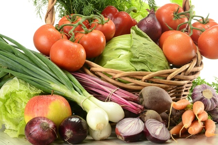 Composition with raw vegetables and wicker basket Stock Photo - 9642806