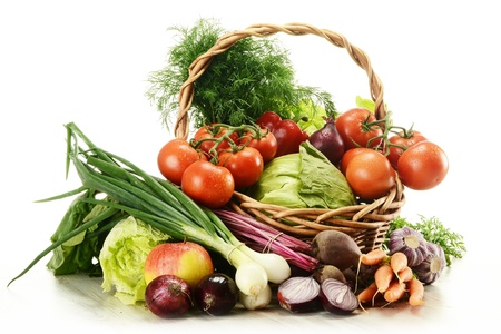 balanced diet: Composition with raw vegetables and wicker basket isolated on white