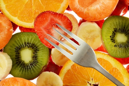 Composition with variety of fruits and fork photo