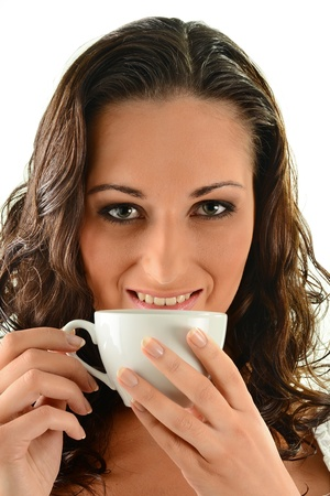 Young woman drinking coffee Stock Photo - 9780697