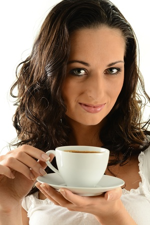 Young woman drinking coffee Stock Photo - 9780699