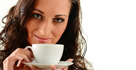 Young woman drinking coffee Stock Photo - 9780690