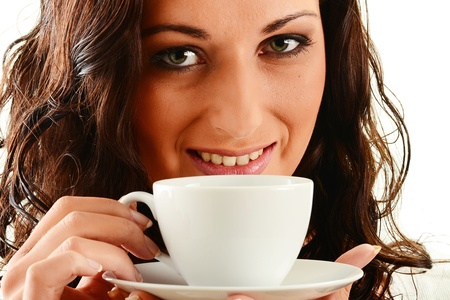 Young woman drinking coffee Stock Photo - 9780696