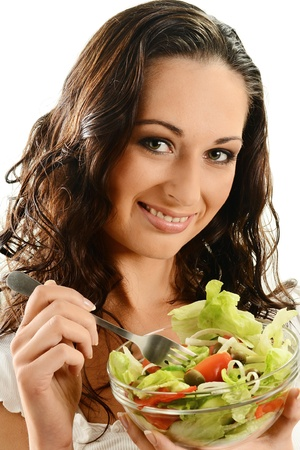 Young woman and vegetable salad bowl Stock Photo - 9780702