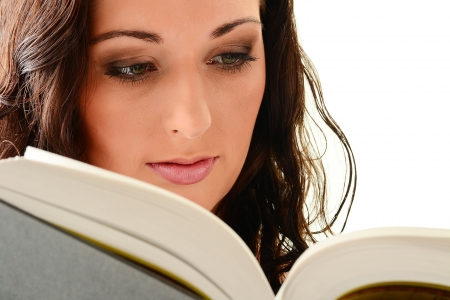Young woman reading a book. Female studnet learnig Stock Photo - 9780688