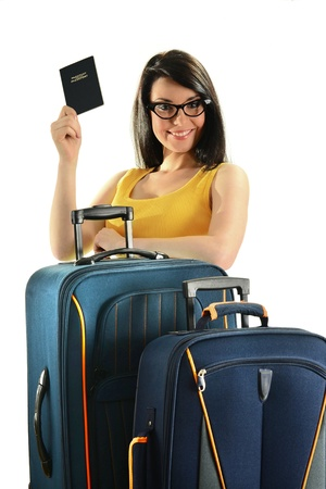 waiting glance: Young female with suitcases holding passport isolated on white
