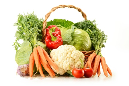 Composition with raw vegetables and wicker basket isolated on white Stock Photo - 9921317