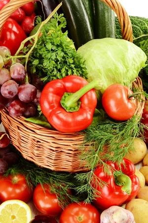 Composition with raw vegetables and wicker basket Stock Photo - 9921400