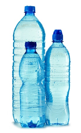 Polycarbonate plastic bottles of mineral water isolated on white background photo