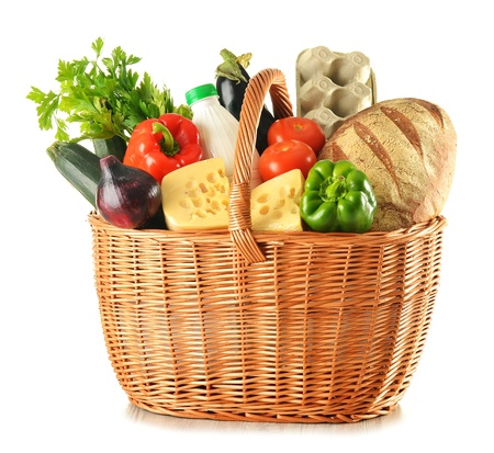 basket: Groceries in wicker basket isolated on white
