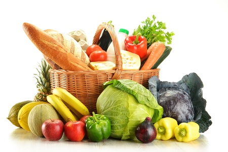 nutrient: Groceries in wicker basket isolated on white