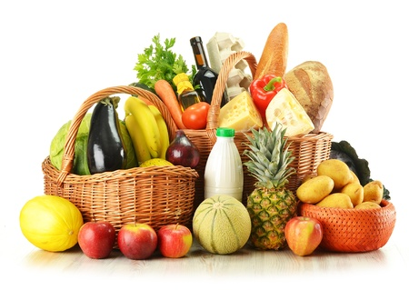 Groceries in wicker basket isolated on white Stock Photo - 10221441