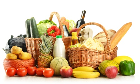 bread basket: Groceries in wicker basket isolated on white