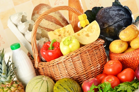 Groceries in wicker basket Stock Photo - 10081573