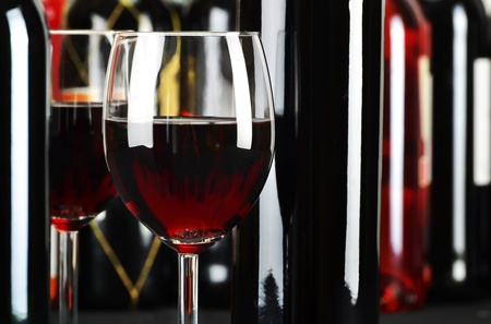 wine food: Composition with glasses and bottles of red wine Stock Photo