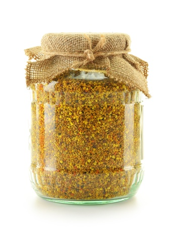 bee pollen: Jar with bee pollen isolated on white. Nutritional supplement Stock Photo