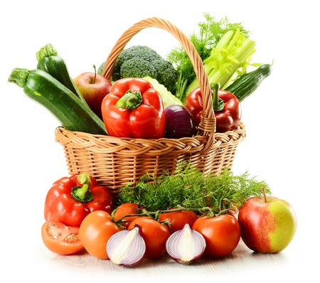 plant antioxidants: Composition with raw vegetables and wicker basket isolated on white