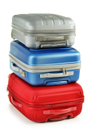 baggage train: Luggage consisting of plycarbonate suitcases isolated on white Stock Photo