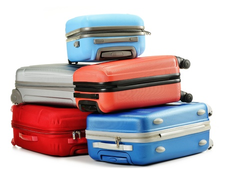 baggage train: Luggage consisting of polycarbonate suitcases isolated on white