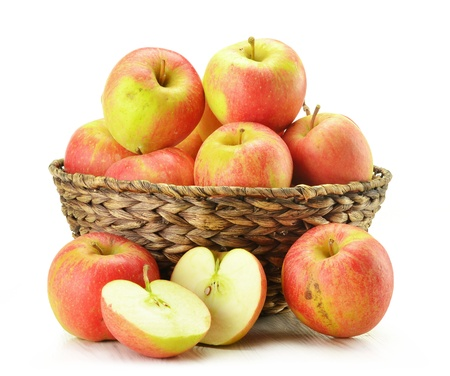 grocery basket: Composition with apples in wicker basket isolated on white