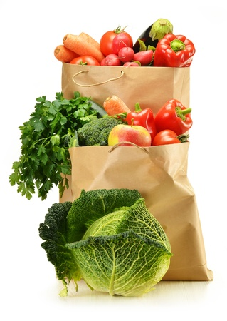 apple paper bag: Composition with raw vegetables and shopping bag isolated on white