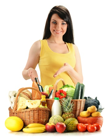 wicker: Young woman with groceries in wicker basket isolated on white Stock Photo