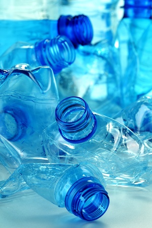 Composition with plastic bottles of mineral water. Plastic waste photo